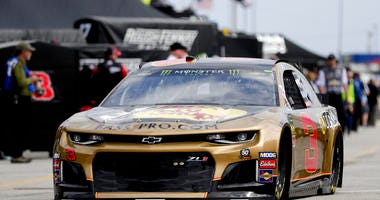 Austin Dillon (3) heads to the track from his garage during NASCAR auto race practice at Daytona International Speedway, Saturday, Feb. 9, 2019, in Daytona Beach, Fla.