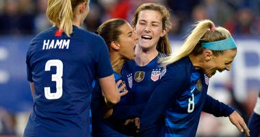 United States forward Tobin Heath, center, celebrates with teammates after scoring a goal against England during the second half of a SheBelieves Cup women's soccer match