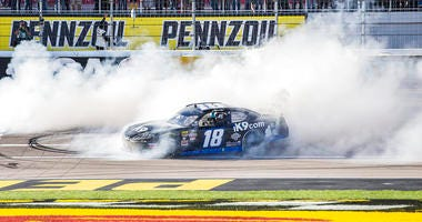 Kyle Busch celebrates with a burnout after winning the NASCAR Xfinity Series auto race Saturday, March 2, 2019, at Las Vegas Motor Speedway in Las Vegas