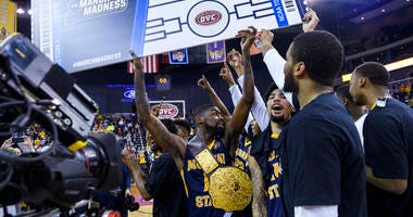 Murray State players celebrate their automatic bid to the NCAA tournament following a win over Belmont in an NCAA college basketball game for the Ohio Valley Conference men's tournament championship in Evansville, Ind., Saturday, March 9, 2019