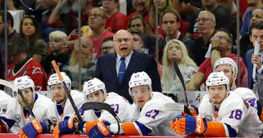 New York Islanders coach Barry Trotz yells during the first period of Game 4 of an NHL hockey second-round playoff series against the Carolina Hurricanes in Raleigh, N.C., Friday, May 3, 2019.