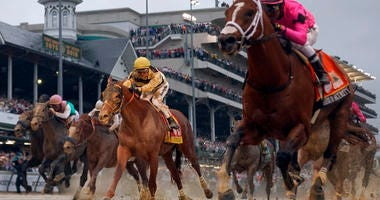 Luis Saez rides Maximum Security, right, across the finish line first against Flavien Prat on Country House during the 145th running of the Kentucky Derby horse race at Churchill Downs Saturday, May 4, 2019, in Louisville, Ky. Country House was declared t