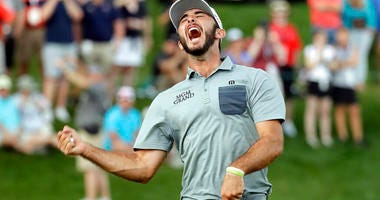 Max Homa celebrates after winning the Wells Fargo Championship golf tournament at Quail Hollow Club in Charlotte, N.C., Sunday, May 5, 2019.