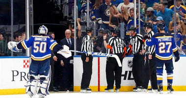 St. Louis Blues goaltender Jordan Binnington (50) and defenseman Alex Pietrangelo (27) argue against the winning goal by the San Jose Sharks in overtime of Game 3 of the NHL hockey Stanley Cup Western Conference final series Wednesday, May 15, 2019, in St