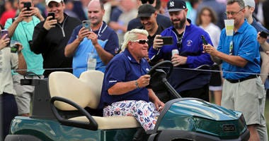 John Daly drives to the 10th tee in a golf cart during the first round of the PGA Championship golf tournament, Thursday, May 16, 2019, at Bethpage Black in Farmingdale, N.Y.