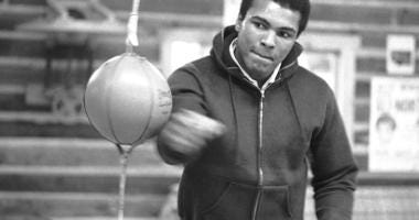 Muhammad Ali punches a bag in his Deer Lake, Pa.,