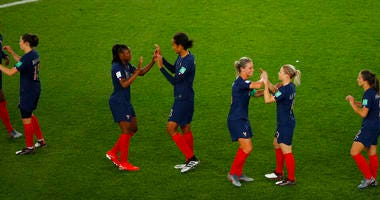 France players celebrate at the end of the Women's World Cup Group A soccer match between France and South Korea at the Parc des Princes in Paris, Friday, June 7, 2019. France won 4-0.