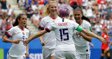 United States' Megan Rapinoe, front, celebrates with teammates after scoring the opening goal from a penalty kick during the Women's World Cup round of 16 soccer match between Spain and US at the Stade Auguste-Delaune in Reims, France, Monday, June 24, 20
