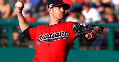 Cleveland Indians starting pitcher Shane Bieber delivers in the first inning of a baseball game against the Kansas City Royals, Tuesday, June 25, 2019, in Cleveland.