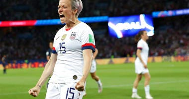 United States' Megan Rapinoe celebrates after scoring her side's second goal during the Women's World Cup quarterfinal soccer match between France and the United States at the Parc des Princes, in Paris, Friday, June 28, 2019