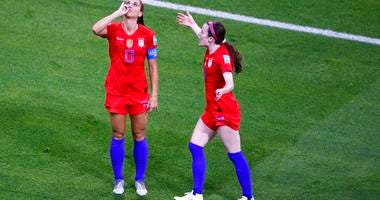 United States' Alex Morgan, left, celebrates her side's second goal during the Women's World Cup semifinal soccer match between England and the United States, at the Stade de Lyon outside Lyon, France, Tuesday, July 2, 2019.
