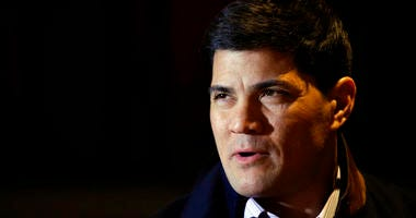 Tedy Bruschi speaks during an interview at the NFL Super Bowl XLVIII