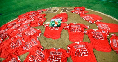 Jerseys with pitcher Tyler Skaggs' number are placed on the mound after the Los Angeles Angels completed a combined no-hitter against the Seattle Mariners during a baseball game Friday, July 12, 2019, in Anaheim, Calif.
