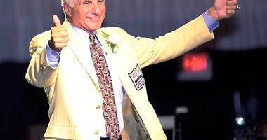 Nick Buoniconti, former Boston Patriots and Miami Dolphins linebacker, gives two thumbs up while being introduced at the Pro Football Hall of Fame