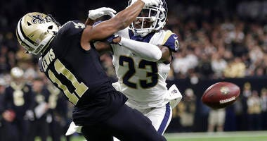 Los Angeles Rams' Nickell Robey-Coleman breaks up a pass intended for New Orleans Saints' Tommylee Lewis