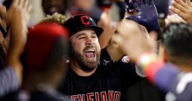 Cleveland Indians' Jason Kipnis celebrates in the dugout after a two-run home run against the Los Angeles Angels during the second inning of a baseball game in Anaheim, Calif., Monday, Sept. 9, 2019. (