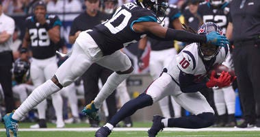 Houston Texans wide receiver DeAndre Hopkins (10) makes a catch in front of Jacksonville Jaguars cornerback Jalen Ramsey (20) during the first half of an NFL football game Sunday, Sept. 15, 2019, in Houston.