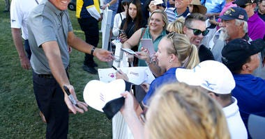 Phil Mickelson signs autographs after finishing the 18th hole during the second round of Shriners Hospitals for Children Open golf tournament at TPC Summerlin in Las Vegas on Friday, Oct. 4, 2019. (