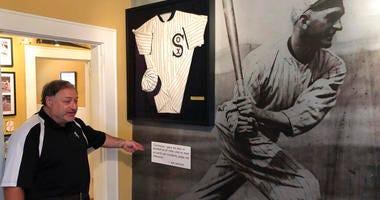 Michael Wallach, managing director of the Shoeless Joe Jackson Museum, looks at replica of a Joe Jackson jersey in Greenville, S.C.