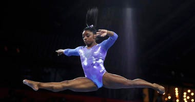 Gold medalist Simone Biles of the United States performs on the balance beam in the women's apparatus finals at the Gymnastics World Championships