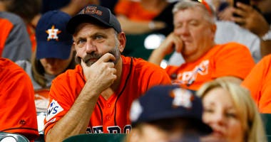Fans watch during the eighth inning of Game 2 of the baseball World Series between the Houston Astros and the Washington Nationals Wednesday, Oct. 23, 2019, in Houston.