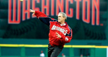 President George W. Bush throws out the ceremonial first pitch at the Washington Nationals home opener in Washington. The Nationals play the Arizona Diamondbacks in the first regular season baseball game in Washington in 34 years.