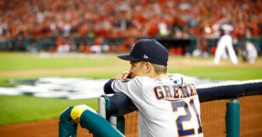 Houston Astros starting pitcher Zack Greinke watches during the sixth inning of Game 3 of the baseball World Series against the Washington Nationals Friday, Oct. 25, 2019, in Washington.