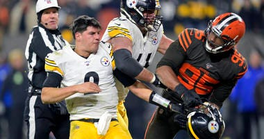 Cleveland Browns defensive end Myles Garrett (95) reacts after swinging a helmet at Pittsburgh Steelers quarterback Mason Rudolph
