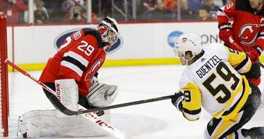 New Jersey Devils goaltender Mackenzie Blackwood (29) stops a shot by Pittsburgh Penguins' Jake Guentzel (59) during the first period of an NHL hockey game Friday, Nov. 15, 2019, in Newark, N.J.