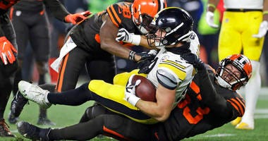 In this Nov. 14, 2019, file photo, Pittsburgh Steelers tight end Vance McDonald (89) is tackled by Cleveland Browns