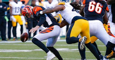 Pittsburgh Steelers outside linebacker Bud Dupree, right, forces a fumble the fumble off Cincinnati Bengals quarterback Ryan Finley, left, before recovering the ball for a turnover during the second half an NFL football game, Sunday, Nov. 24, 2019, in Cin
