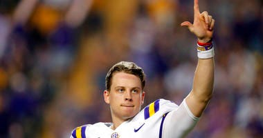 LSU quarterback Joe Burrow, who is considered a frontrunner for the Heisman Trophy, acknowledges the crowd as he is pulled from his last game in Tiger Stadium, in the fourth quarter of the team's NCAA college football matchup against Texas A&M in Baton Ro