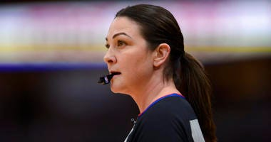 Referee Lauren Holtkamp-Sterling watches during the first half of an NBA basketball game between the Chicago Bulls and the Golden State Warriors on Friday, Dec. 6, 2019, in Chicago. This is Holtkamp-Sterling's first game back since giving birth.
