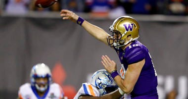 Washington quarterback Jacob Eason (10) passes under pressure from Boise State nose tackle Scale Igiehon (90) during the second half of the Las Vegas Bowl NCAA college football game at Sam Boyd Stadium, Saturday, Dec. 21, 2019, in Las Vegas.