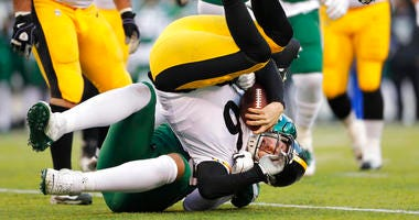 Pittsburgh Steelers quarterback Devlin Hodges (6) is stopped by New York Jets defensive end