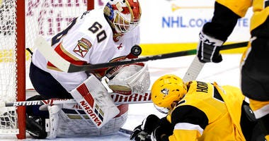 Florida Panthers goaltender Chris Driedger stops a shot by Pittsburgh Penguins' Patric Hornqvist