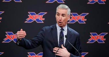 """FILE - In this Feb. 25, 2019, file photo, XFL Commissioner Oliver Luck gestures during a press conference in Seattle. When the XFL debuts in February, it will take a """"Star Trek"""" approach of going where no football league has gone before."""