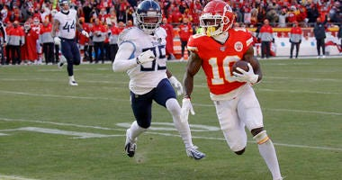 Kansas City Chiefs' Tyreek Hill runs for a touchdown during the first half of the NFL AFC Championship football game against the Tennessee Titans Sunday, Jan. 19, 2020, in Kansas City, MO.