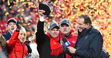 Norma Hunt, left, and her son Clark Hunt, center, owners of the Kansas City Chiefs, and Kansas City Chiefs head coach Andy Reid, second right, celebrate after the NFL AFC Championship football game against the Tennessee Titans Sunday, Jan. 19, 2020, in Ka