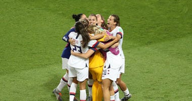 Alex Morgan of the USA celebrates victory with her team mates after the 2019 FIFA Women's World Cup France Quarter Final match between France and USA at Parc des Princes on June 28, 2019 in Paris, France.