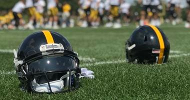 Steelers helmets on the field at Saint Vincent College in 2019 training camp
