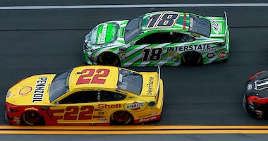Joey Logano, driver of the #22 Shell Pennzoil Ford, and Kyle Busch, driver of the #18 Interstate Batteries Toyota, during Coke Zero 400 Practice At Daytona International Speedway