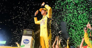 Kyle Busch Celebrates Winning NASCAR Monster Energy Cup Series Championship