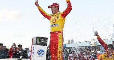Team Penske's Joey Logano Celebrates In Victory Lane After Winning The Monster Energy NASCAR Cup Series Race At Michigan