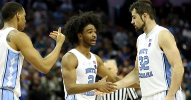 North Carolina's Coby White and Luke Maye slap high-five during the 2019 ACC tournament.