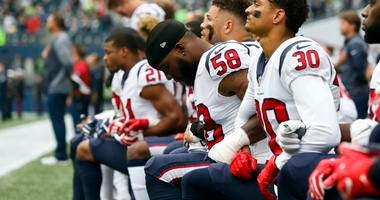 Players kneeling for national anthem