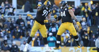 Pittsburgh Steelers defensive end Stephon Tuitt (91) and defensive end Tyson Alualu (94) celebrate a defensive play during the third quarter against the Jacksonville Jaguars in the AFC Divisional Play...