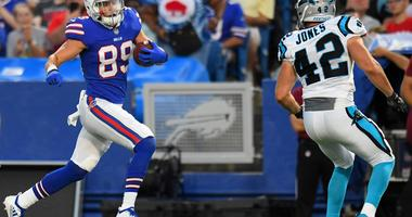 Buffalo Bills wide receiver Brandon Reilly (89) runs with the ball after a catch as Carolina Panthers defensive back Colin Jones