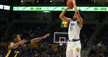 Pittsburgh Panthers guard Justin Champagnie (11) shoots a three point basket against Canisius Golden Griffins forward Jalanni White (4) during the second half at the Petersen Events Center.
