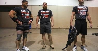 Competitors relax during the strongest man competition